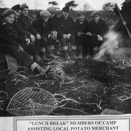 PoWs (probably Ukrainian) assisting a local potato grower.jpg