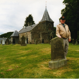 Lewis Jenkins by the grave of another member of the Newfoundland Timber Corps, Abbey St Bathans.jpg