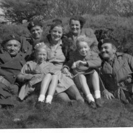 Polish soldiers relaxing with locals.jpg