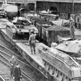 Polish tanks on low loaders, Haddington station.jpg